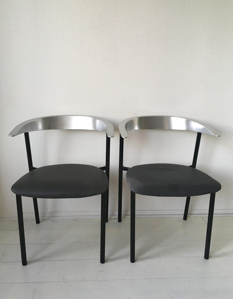 Rare set of four Minimalist, industrial metal chairs in style of Borek Sipek Ota Otanek chair and PK 11 chair by Fritz Hansen. The chairs feature a metal base with dark fabric upholstered seating's. They remain in good and sturdy condition with wear