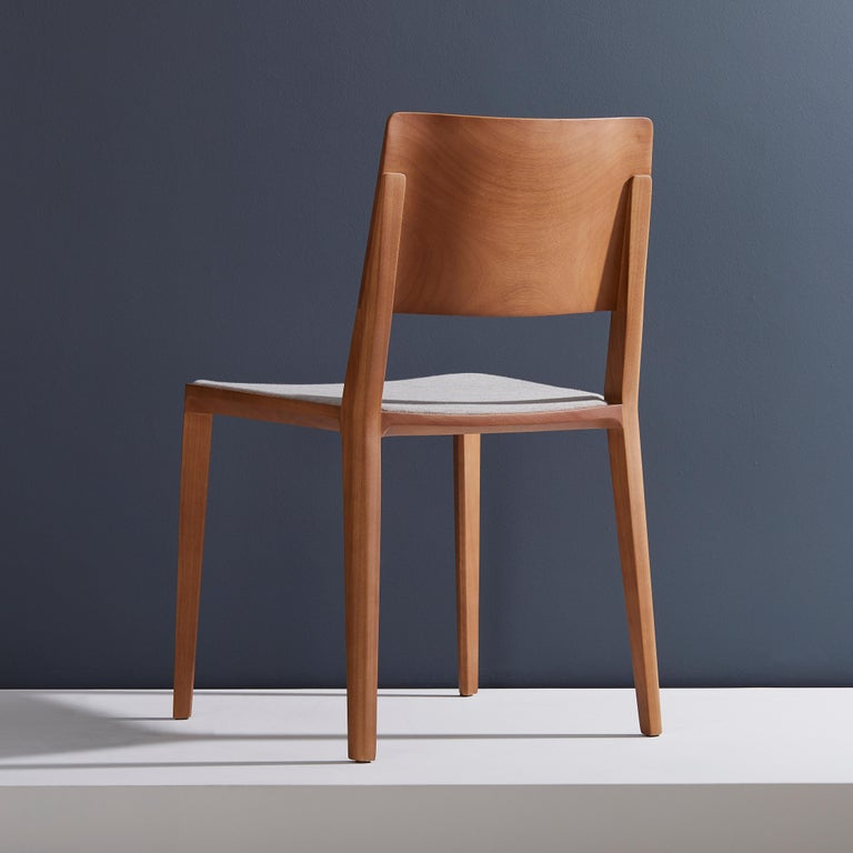 Modern Minimalist modern Chair in natural solid wood upholstered textile seating For Sale