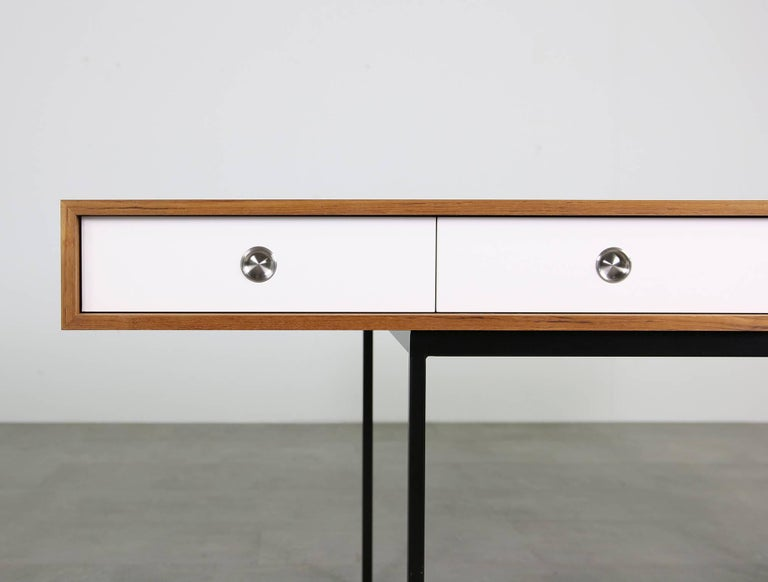 The Nathan Lindberg desk. Model NL40 in beautiful teak wood and metal base, white edition, with white HPL drawers. Super high quality writing table, freestanding, maple wood inside the drawers, stainless steel handles. Measures: Desk 180 x 80 x 76