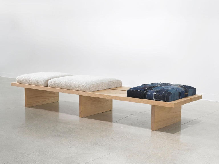 The 'Heroes Bench' was inspired by the clean solid oak planks and designed to emphasize the beauty and simplicity of the materials nature. The adjustable seat cushions are upholstered in Natural Bouclé made by David S Gibson custom weavers and a