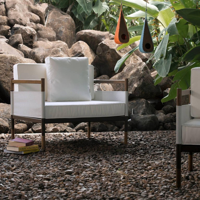 This outdoor Lounge chair is made to order in hardwood, metal and fabrics. Also classified as an armchair, the multi-finish structure is combined with outdoor fabrics such as the Batyline to create an interesting outdoor solution. Bellow the full