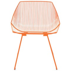 Minimalist Outdoor Wire Lounge Chair, the Bunny Lounge in Orange