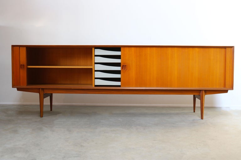 Gorgeous Minimalist sideboard / credenza by designer Oswald Vermaercke for V-Form in the 1950s. The sideboard has a amazing clean design. The tambour doors disappear completely when opened and the craftsmanship on this piece is exceptional. Amazing