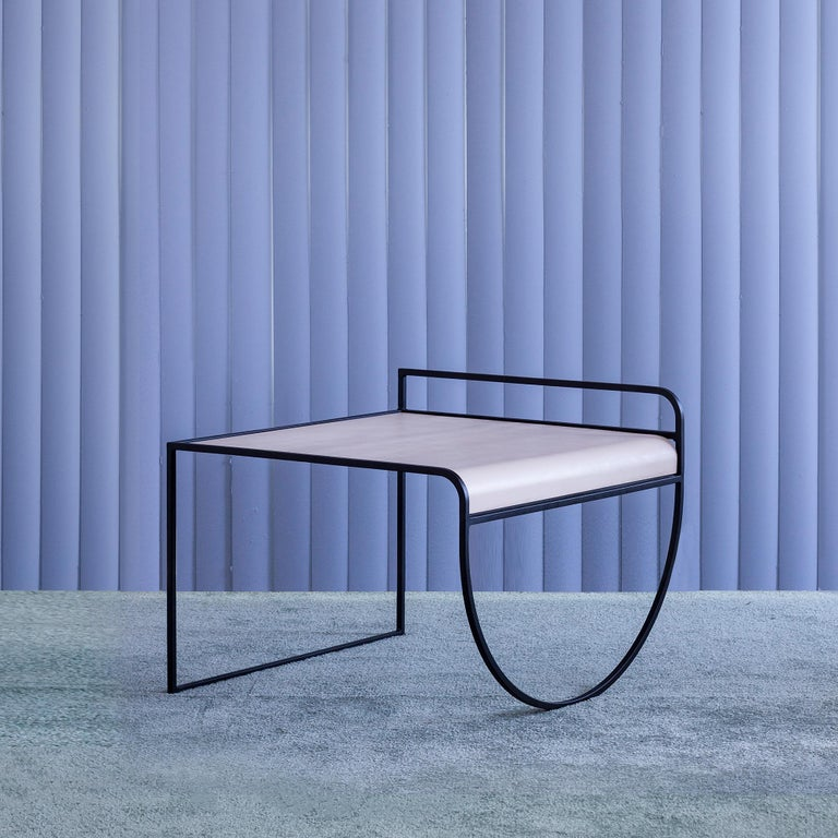 A strikingly pure composition with a sharp use of line and tantalizing stance on a belly-arched base, the sw side table by American design duo soft-geometry makes the most of its minimal form. The table features a black powder-coated steel frame