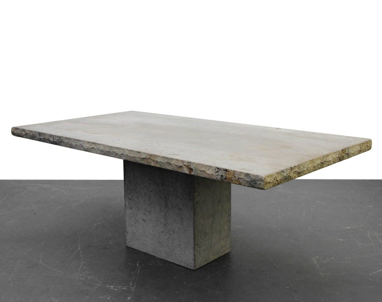 Nothing short of amazing. Solid travertine dining table straight from Italy. Has the appearance of polished concrete. A clear finish could be applied to bring out more of the color in the travertine, but we love the Industrial, raw appearance, of