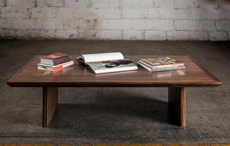 This modern, minimalist and aesthetic coffee table. Masterfully handcrafted of beautiful black walnut, it is a study in simplicity and finely tuned proportions.