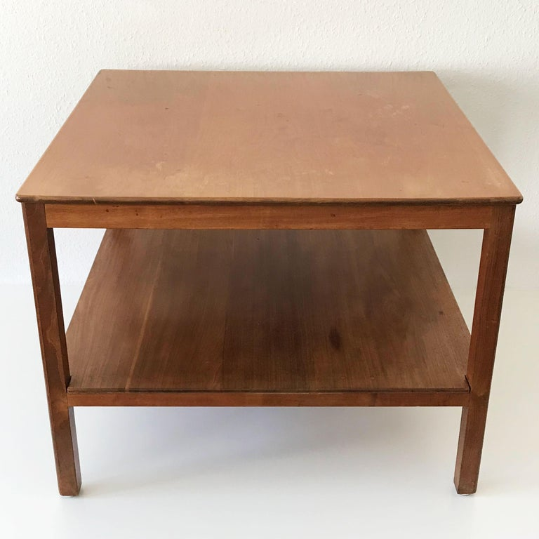 Exceptional coffee table in a minimalistic design by Kaare Klint. 1932. Manufactured by Rud Rasmussen, Copenhagen, Denmark in 1934 (by Rud Rasmussen confirmed). Makers label under the upper plate.  Executed in Cuban mahogany. Original condition.