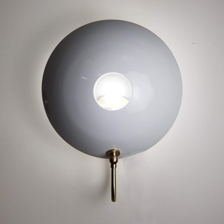 MiniPOP wall sconce--a more compact version of our wildly popular 4 foot tall POP wall lamp. Shown in natural brass and our