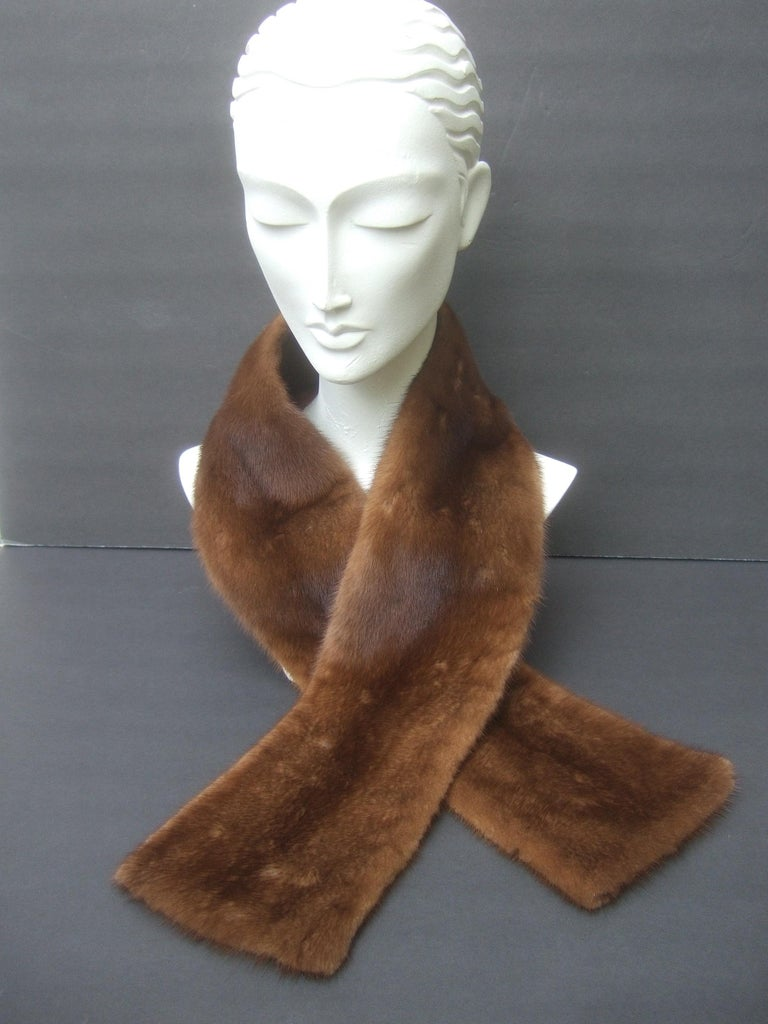 Plush mink fur collar designed by Pologeorgis for Neiman Marcus c 1990s The luxurious brown mink fur collar is backed with brown satin acetate  Makes a very chic accessory wrapped around the neck   Designed without hooks or closures; rather wraps