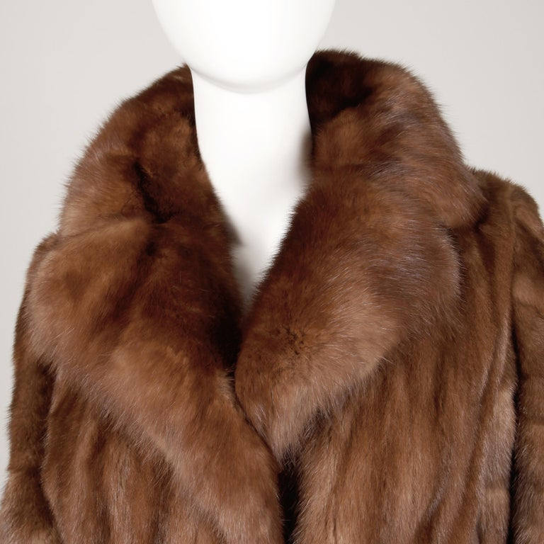 Stunning vintage demi buff mink fur coat with a plush sable fur collar from the estate of Pamela Lewis (Jerry Lewis, Gary Lewis). Light weight female mink pelts are beautifully matched. Diagonal flared sleeves and flared sweep. Fully lined with