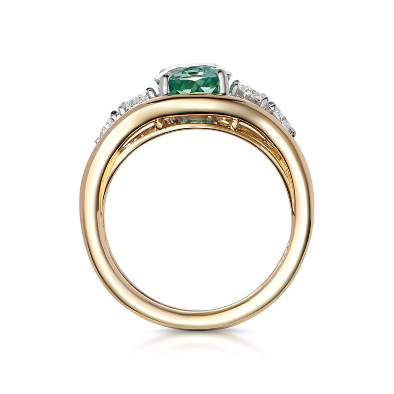 A spectacular Green Tourmaline set with 4 oval cut and white diamonds. This unique, one-of-a-kind statement ring is handmade in London in historic jewelry quarter, Hatton Garden.   Tourmaline: 2ct Diamonds: 0.80ct  Karat: 18k yellow gold with white
