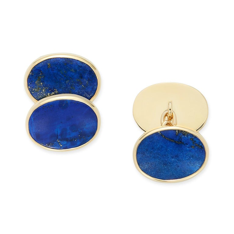 A pair of striking Lapis Lazuli cufflinks set in 18 karat yellow gold with full gold back and chain links. Natural Lapis with natural inclusions creating a classic pair of very wearable cufflinks. Perfect for weddings, Christmas, fathers day and