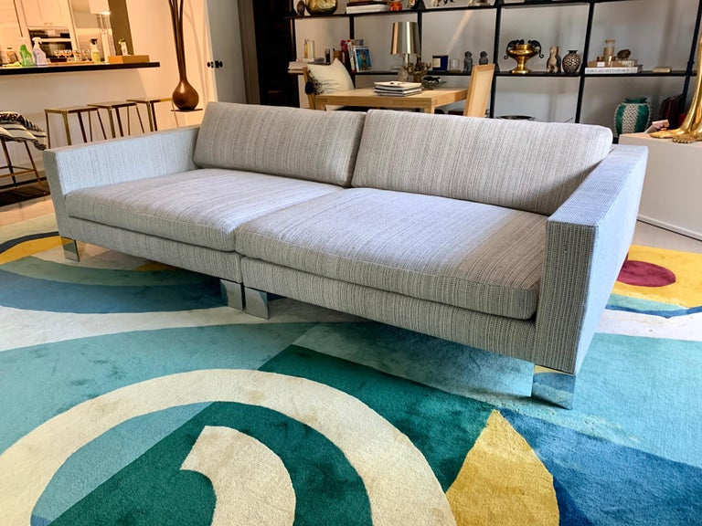 This lovely large square designed Minotti sofa sectional in two pieces can easily be put together for a deep lounge space or apart for individual seating, circa 1990s. Retains original labels and reupholstered in a heavy weave cotton rag style