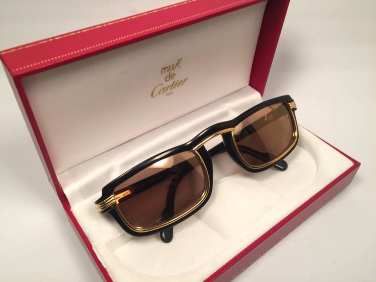 New 1991 Original Cartier Vertigo Art Deco Sunglasses with spotless amazing brown gold mirrored (uv protection).  Frame has the famous real gold and white gold accents in the middle and on the sides. All hallmarks. Cartier gold signs on the