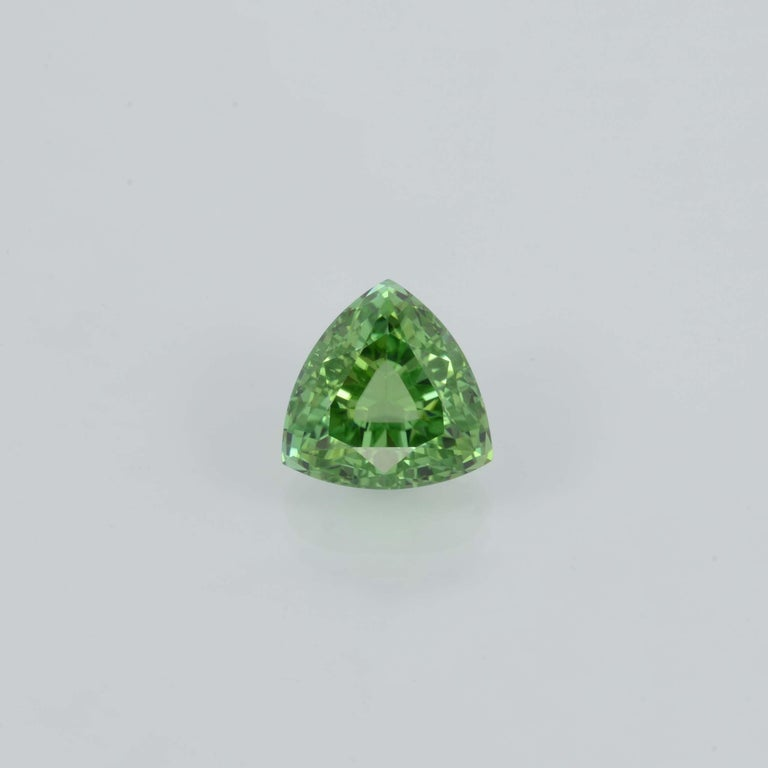 Bright 6.48 carat Mint Green Tourmaline trillion shaped gem, offered loose to a very unique lady or gentleman. Returns are accepted and paid by us within 7 days of delivery. We offer supreme custom jewelry work upon request. Please contact us for