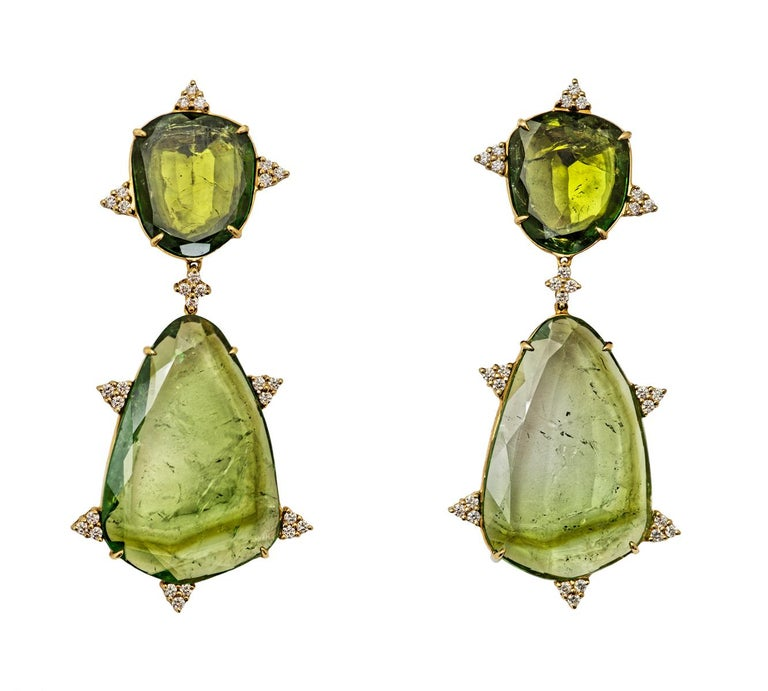 Pair of mint tourmaline slice earrings, accented with circular-cut diamond trefoil motifs, mounted in 18K gold.  Description: Gem Material Details: The mint tourmaline slices are all Brazilian in origin and together weigh approximately 106.83 cts.