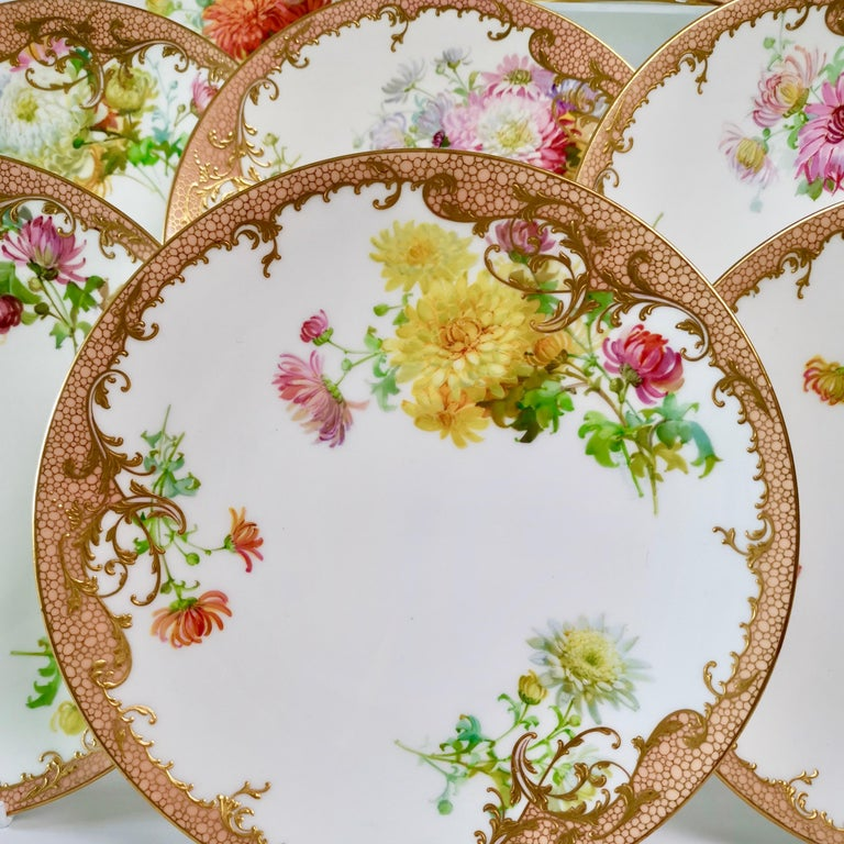 This is a stunning dessert service made by Minton in 1894, hand painted with beautiful chrysanthemums by Anton Connelly. The service consists of 10 plates and 3 low footed comports. Each piece is signed by the artist.