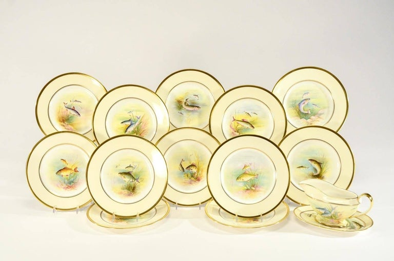 This a complete Minton fish service that is hand painted and Artist-signed consisting of 12 plates which measure 9.75
