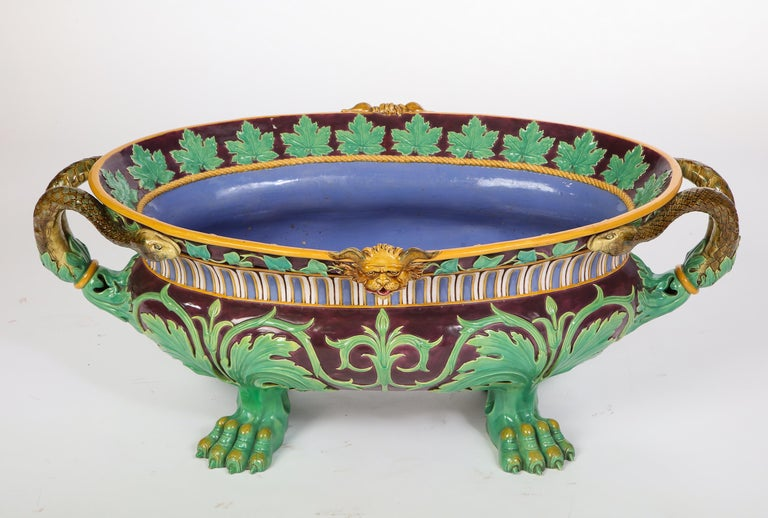 Recorded as shape no. 719, designed by Carlo Marochetti.   In the Italian Renaissance taste, of oval form flanked by bifurcated snake handles with acanthus terminals, the rim interior applied with grape leaves, the exterior with ivy interrupted by