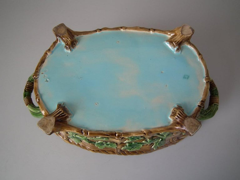 Minton Majolica game pie dish with liner which features a hare, mallard and blackbird on a bed of fern and oak leaves. Coloration: brown, green, turquoise, are predominant. The piece bears maker's marks for the Minton pottery. Marks include a