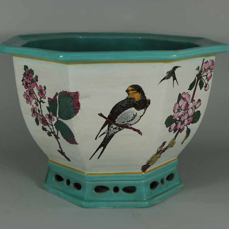 Minton Majolica jardinière which features illustrated flora and fauna, including: a partridge, corn & barley, swallows, a bee, a bullfinch on a blossoming branch and flowers. Artist and designer, William Stephen Coleman, was paid £200 by Minton for