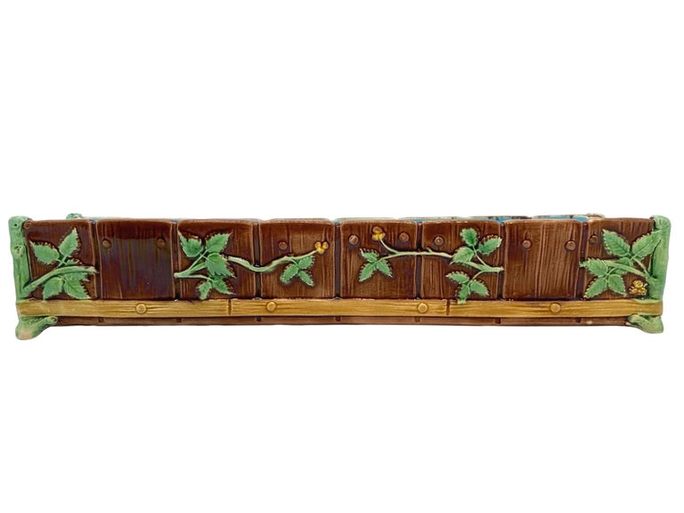 Minton Majolica Small Jardiniere, realistically molded as a simulated water trough formed by faux wooden staves and pegs, overlain with budding Hawthrone branches, the corners formed as mossy posts, banded near the base with pegged logs, the