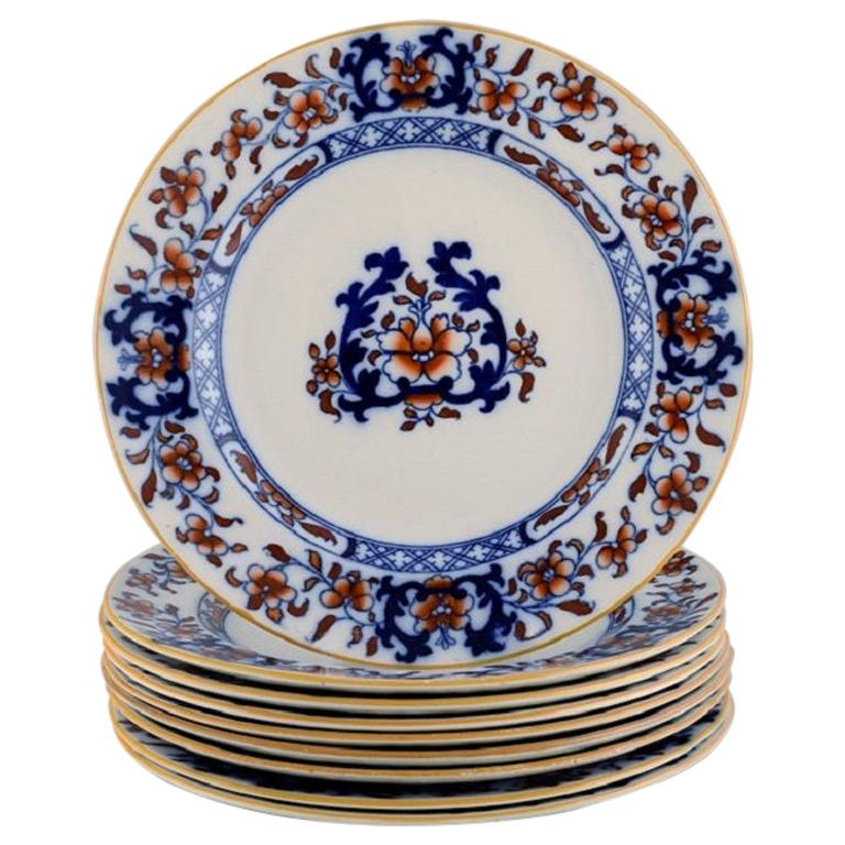 Mintons, England, Nine Antique Dinner Plates in Hand-Painted Faience