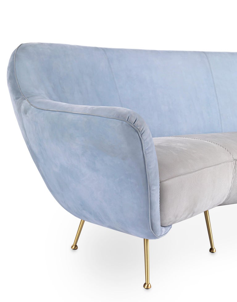 The Mio sofa designed by Draga & Aurel for Baxter is a sofa with leather upholstery. Frame in pine and poplar plywood. Turned and satin-finished brass feet. Differentiated density polyurethane foam filling with acrylic fibre cover. Seat with coil