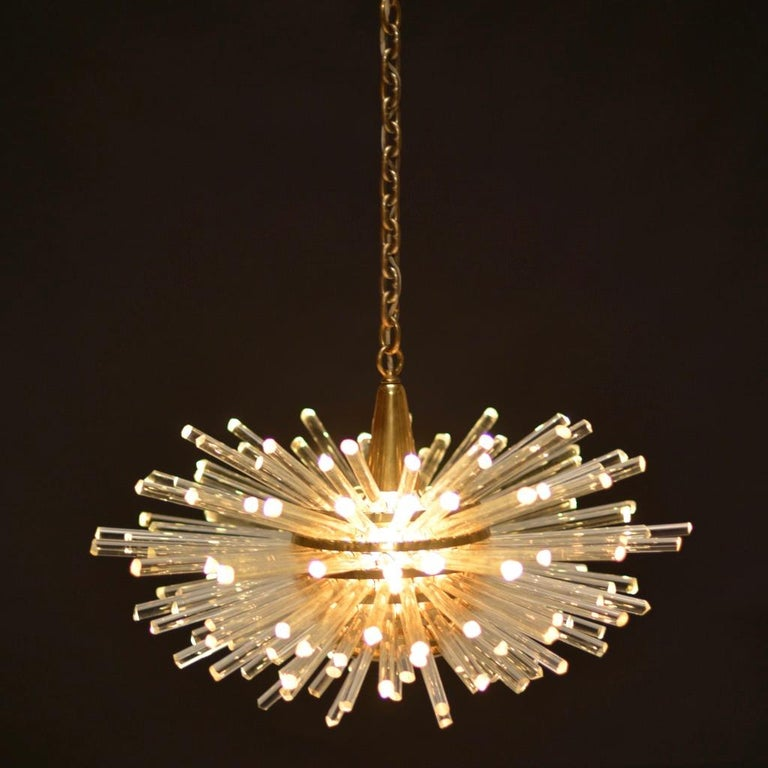 Miracle chandelier designed by Prof. Friedl Bakalowits for Bakalowits & Söhne This Sputnik crystal glass and brass chandelier was made in Austria, manufactured in the 1960s. The layered multi-tier structure is made of solid brass rings and glass