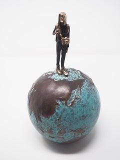 Adventure- contemporary figurative bronze sculpture of a woman on a blue globe