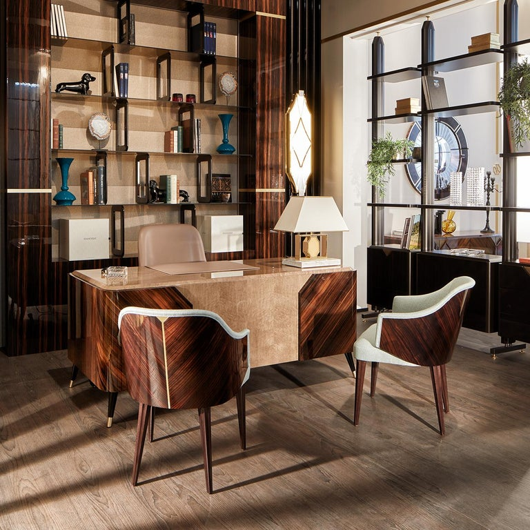 Reminiscent of Mid-Century Modern design, the Miriam chair features a natural Macassar ebony shell with a high gloss finish, bringing out the wood's natural veins. On tapered legs with metal inserts for additional strength, the chair can be