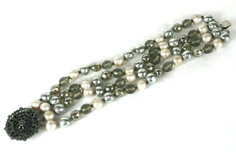 Miriam Haskell Pearl and Crystal Bead Bracelet. 4 strand bracelet with faux cream, grey pearls and smokey crystal beads. Antique silver filigree clasp.  7.5
