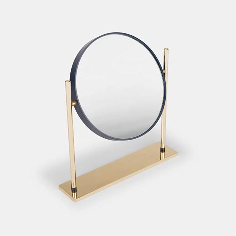 Mirro designed by Federica Biasi for Mingardo. Mirrò is a small desktop and bathroom mirror, a refined object that reveals its integrity through its dimensions and the color of the band that outlines the mirror. It is both simple and serious in the