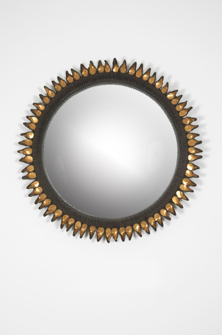 Circular convex mirror in black talosel and gold mirror, background with its original canvas. Signed Line Vautrin XII on the back.
