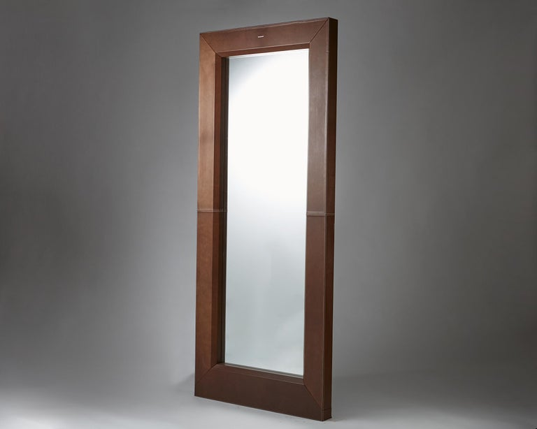 Wood, leather and mirrored glass. Measures: H 210 cm/ 6' 11