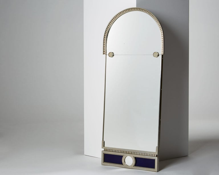 Mirror designed by Herman Bergman, Sweden. 1930s. Chromed brass and mirrored glass.  Measures: H 73.5 cm/ 29