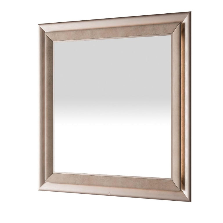 Stylish and sophisticated, this enchanting mirror features nubuck leather and a metal effect lacquered frame. With its soft beige color, it is the perfect choice to compliment the contemporary decor in any room, and comes complete with an LED