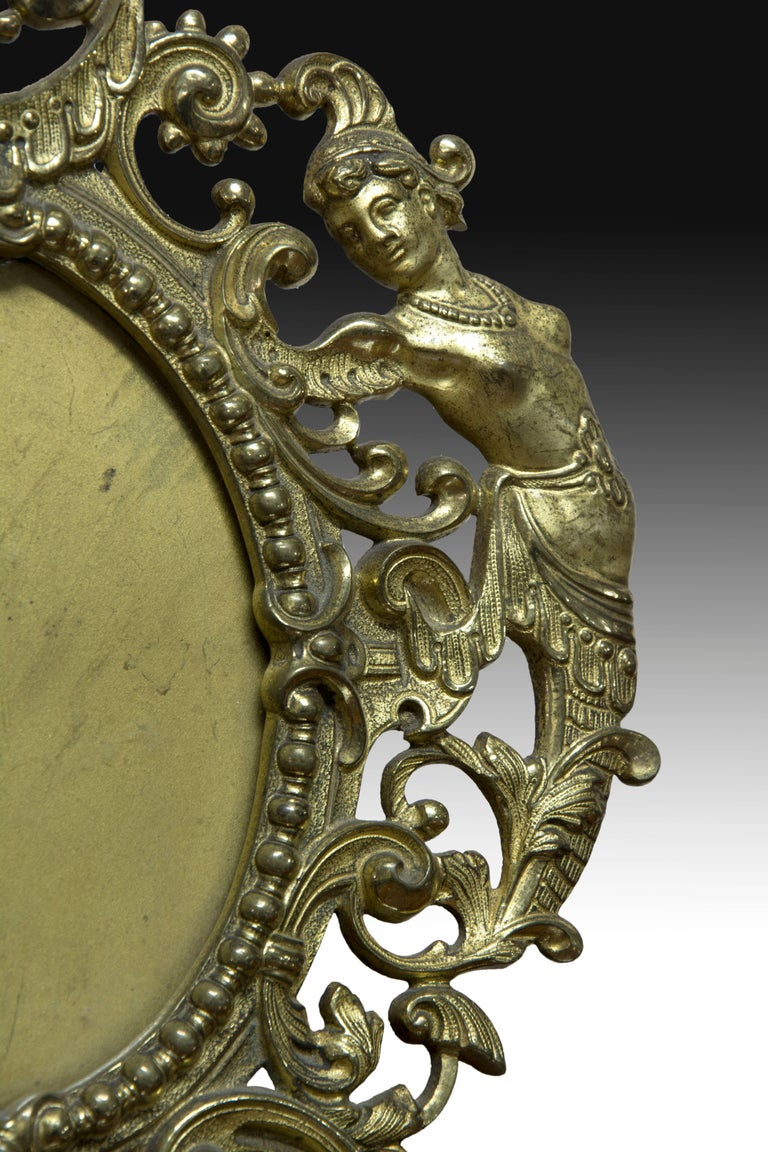 Bronze frame for a table mirror (or a miniature) decorated with
