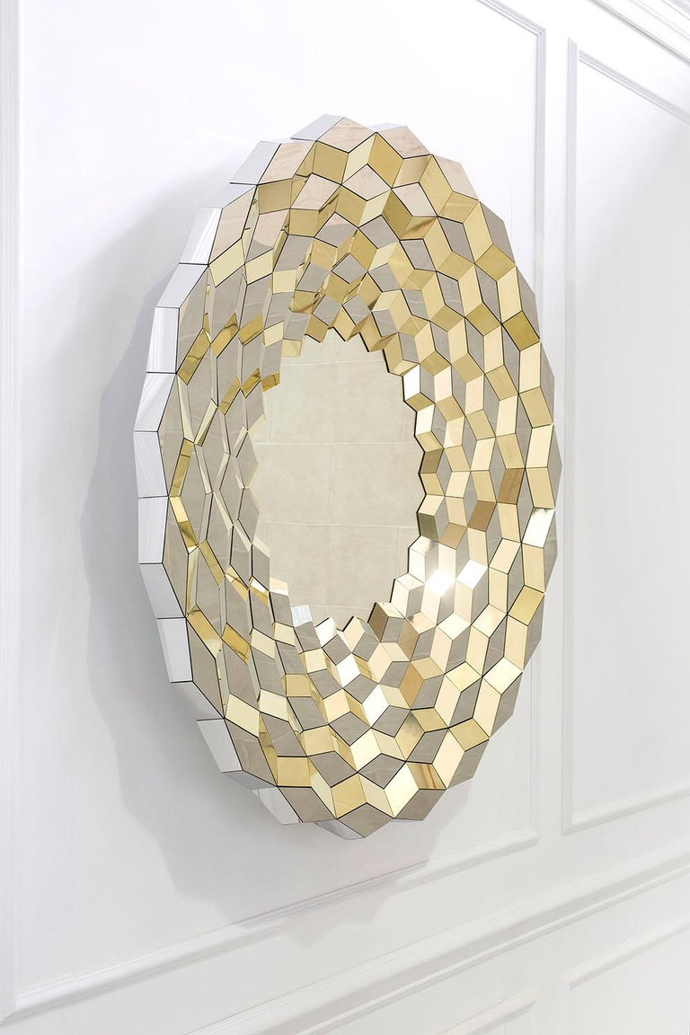 Of all things, a long haul flight to China helped inspire this faceted mirror. When seen from the air, the still water that had been collected in hundreds of terraced paddy fields, cut deep into the valley sides, caught the early morning light
