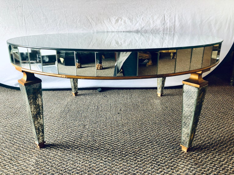 Mirrored circular Art Deco style coffee or low table in a distressed look.