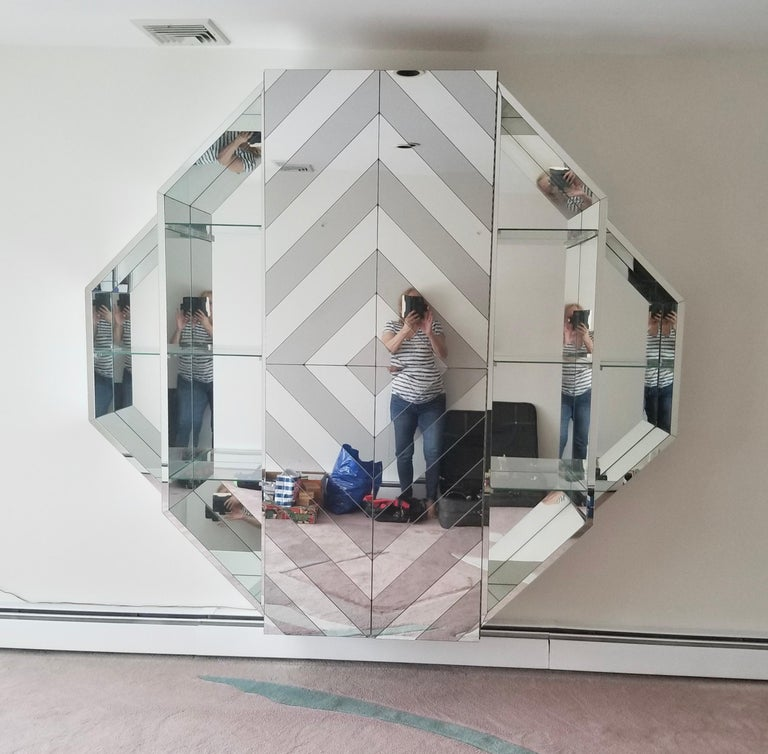 Custom made wall-mounted octagonal mirrored bar cabinet, circa 1980, USA.