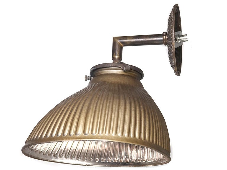 This collection of matching offset X-Ray shades make an interesting sconce. They still have the beautiful original mirrored interior and have a gold outside finish. The ribbed glass has a wonderful aged patina. It's a versatile design that fits