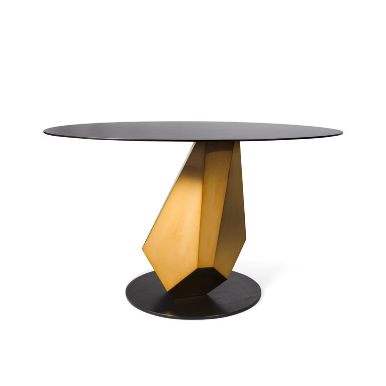 Currently 1 in Stock, Ready to Ships within 2-3 Days   The Madison table is an opulent piece of furniture that exemplifies the blending of functionality with sculpture. The base explore balance and natural geometric forms, while supporting a modern