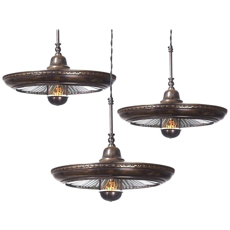 We have a nice collection of these Classic mirrored ring pendants. In addition to the fluted mirror there are some subtle decorative details that make this one stand out. The most interesting feature is the bulb cover with three springs and a hole
