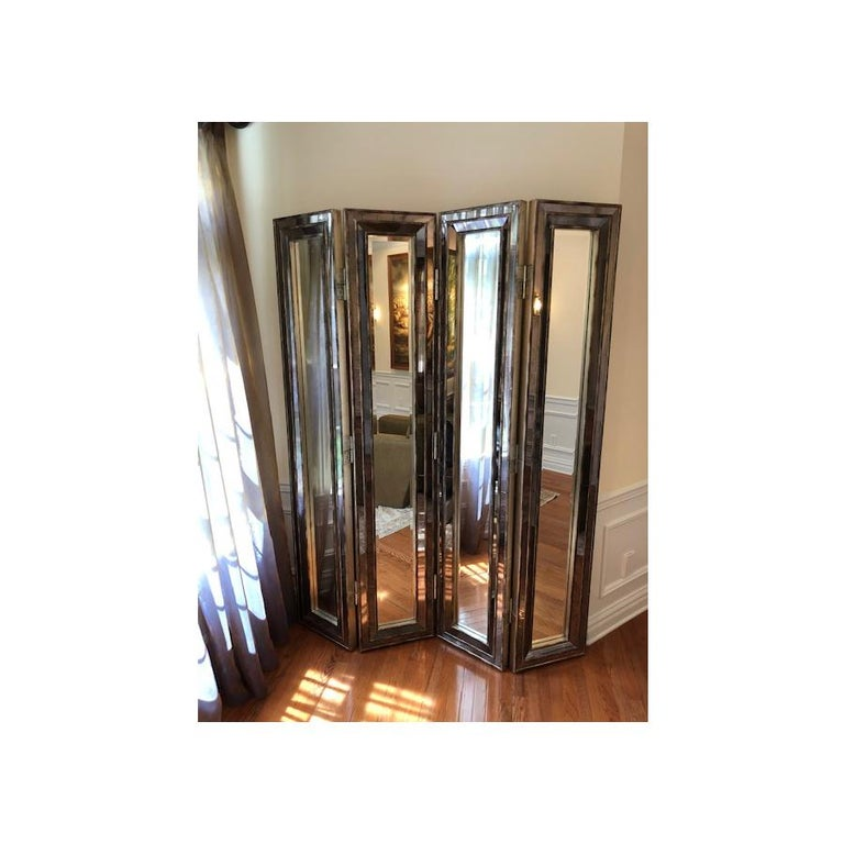 A 4 panel mirrored screen or room divider. Measures: Height 7', width 16