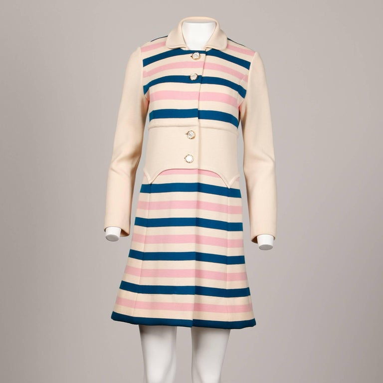 Darling vintage Italian wool striped knit coat in candy colored stripes. Pearl buttons and dramatic wide waistband. Unlined. 100% wool. There is no marked size but the coat fits like a modern size small. The bust measures 34-36