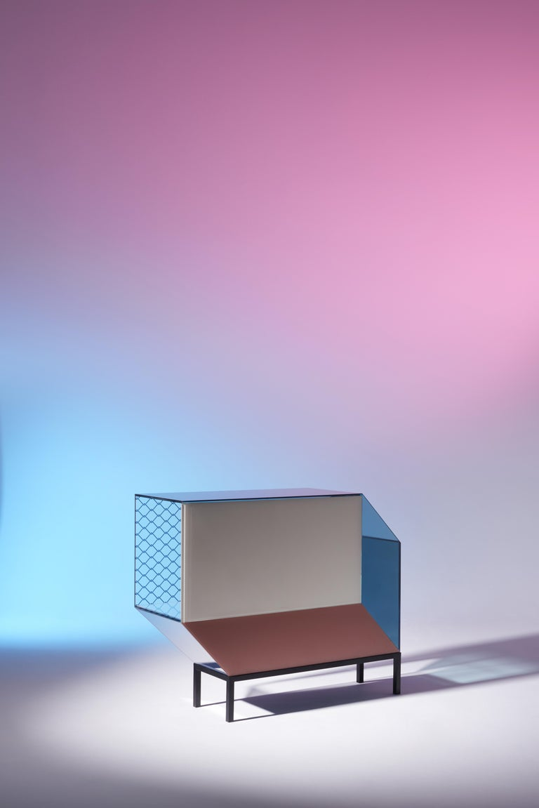 Prototype. Miscredenza is a series of architectural furniture designed by Patricia Urquiola enhanced by colored glass printed with Federico Pepe's patterns. The collection comprises a sideboard, a vertical bookcase and a horizontal