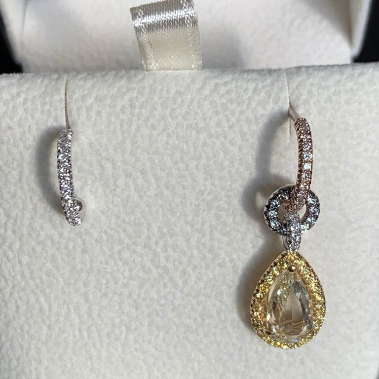 Mismatched Hoop earrings with removable charm handmade in Belgium by jewelry artist Joke Quick, in solid 18K Yellow, Rose & White gold and handmade the traditional way ( no casting or printing involved ). One of the two hoop earrings is made in