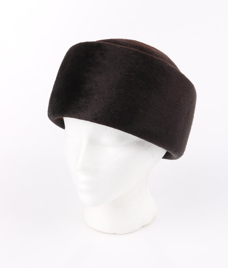 Miss Dior CHRISTIAN DIOR c.1960's Marc Bohan Dark Brown Felted Fur Pillbox Hat    Circa: 1960's Label(s): Miss Dior By Christian Dior Designer: Marc Bohan Style: Hat Color(s): Brown Lined: Yes  Unmarked Fabric Content: Felted Fur (exterior);