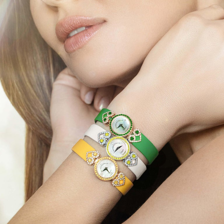 Miss Victoria Emerald Green is a luxury diamond watch for women crafted in 18kt Yellow gold, featuring the mother-of-pearl dial, quartz movement. The case, dial and buckle are set with white Ideal Cut and green emeralds. It is an 18mm classy